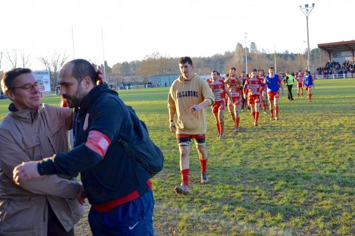 Rugby LSC - Éric Daubriac félicite Christophe qui semble encore dans le match
